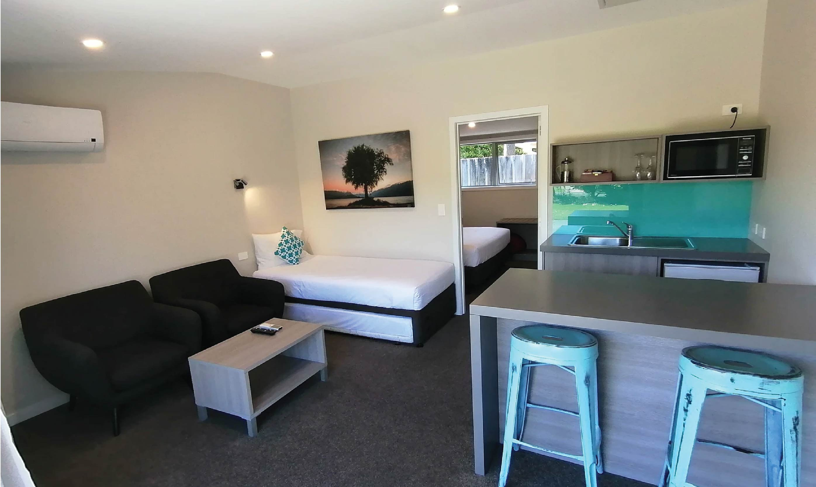 The lounge area of Edgewater Motels superior one-bedroom motel unit.